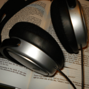 Headphones resting on a book - Writers' Christmas gift guide